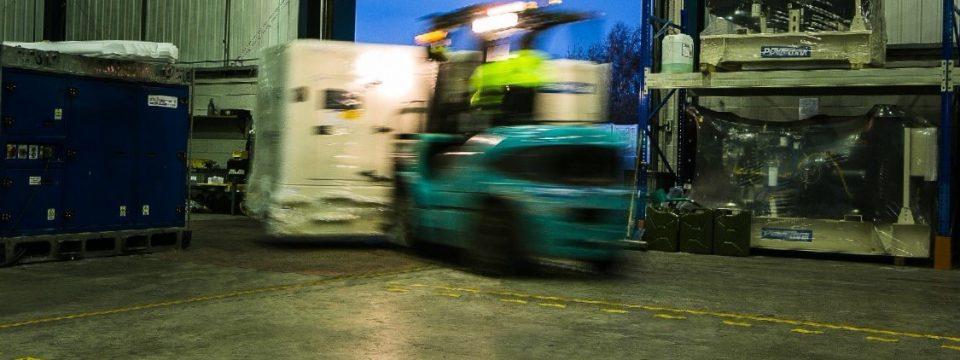 Forklift moving diesel generator
